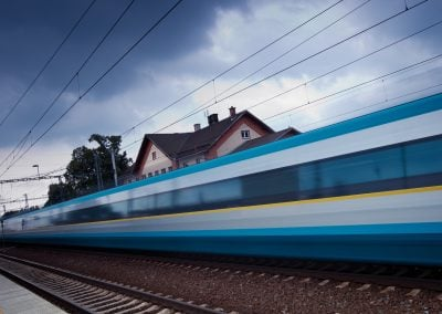 Fast train passing by (motion blur is used to convey movement; c